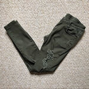 Love Culture • distressed army green skinny jeans